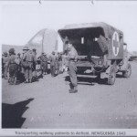 Transporting walking patients to Airfield. NEW GUINEA 1943