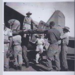 Loading wounded onto aeroplane at Popondetta NEW GUINEA 1943