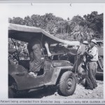 Patient being unloaded from Stretcher Jeep - Launch Jetty NEW GUINEA 1943