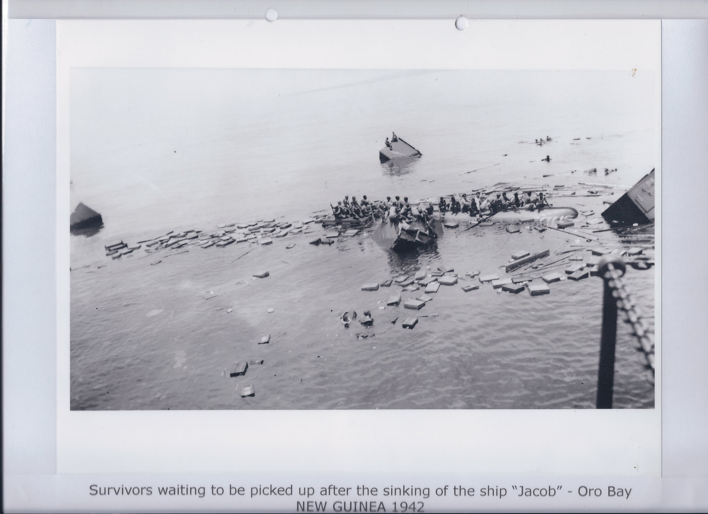 "Survivors waiting to be picked up after the sinking of the ship ""Jacob"" - oro Bay NEW GUINEA 1942"