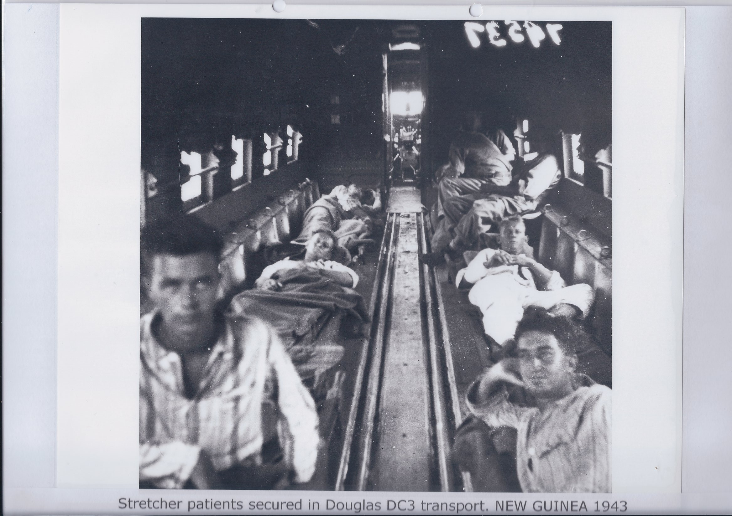 Stretcher patients secured in Douglas DC3 transport. NEW GUINEA 1943