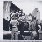 Loading stretcher patients onto plane - Dreger Harbour NEW GUINEA 1943