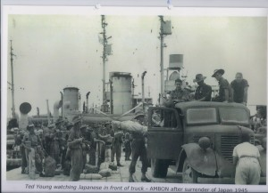 Ted Young watching Japanese in front of truck - AMBON after surrender of Japan 1945